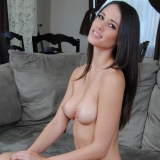 Tiffany Thompson with white lingerie and a purple dildo